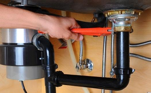 detaching garbage disposal to fix leak from top