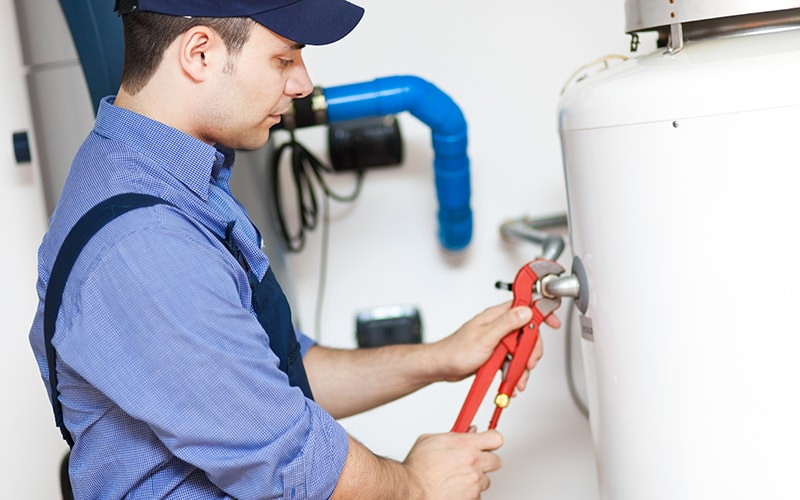 working on a tank water heater