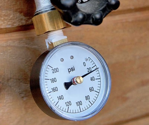 use a gauge to measure water pressure