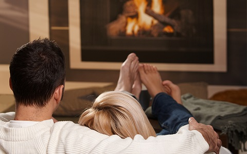 a couple enjoying a fire